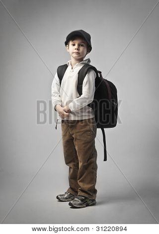 Child carrying a backpack