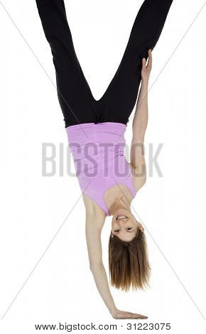 Pretty woman doing handstand balancing on one hand, isolated on white.