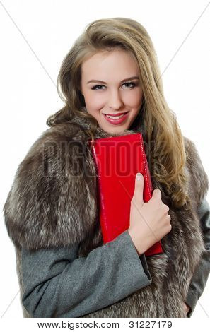 The beautiful girl with a red handbag