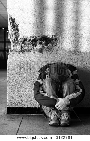 Boy Teens Sitting On The Floor Alone In City (Series Teenagers)