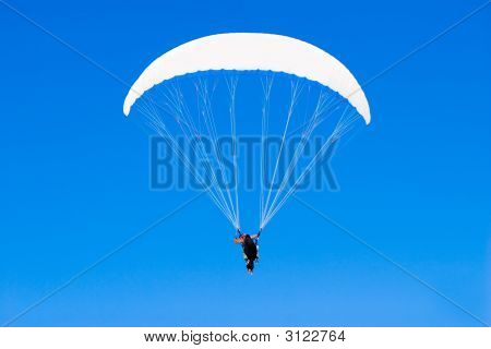 A Paraplane Flying High Up In The Deep Blue Sky (Series Sport, Extreme, Mountains, And Teenag