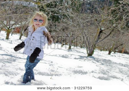 Little Girl Playing in the Snow