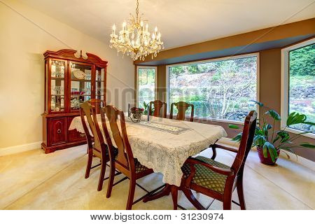 Dining Room With Large Window In American House.
