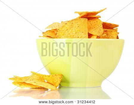 tasty potato chips in green  bowl isolated on white