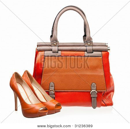 Pair of open-toe female shoes and handbag