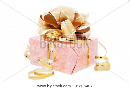 Festive Packed Rosy Nacreous Present With Golden Bow Isolated On White Background
