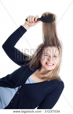 Woman Painful Hairdressing Using Hairbrush