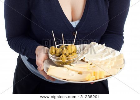 Woman Holding Plate With Fresh Olives And Cheese