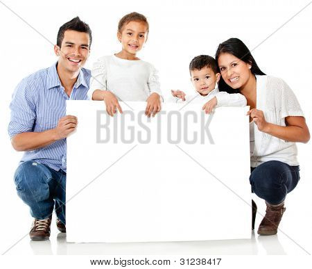 Familie holding einen Banner and smiling isolated over a white background