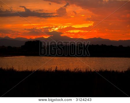 Flaming Sky Over Peak And Lake