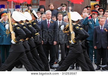 MOSCOW - MAY 8: Moscow Mayor Sergei Sobyanin, State Duma deputies and veterans look military parade at Victory Day, on May 8, 2011, Moscow, Russia.