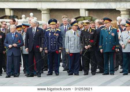 MOSCOW - MAY 8: Russian Federation State Duma deputies and veterans at laying of wreaths at tomb of Unknown Soldier on Red Square, on May 8, 2011, Moscow, Russia.