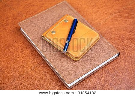 Business Still-life With  Notebook And  Pen