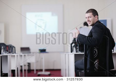 young business man giving presentation and education leassons on seminar event in small bright conference room
