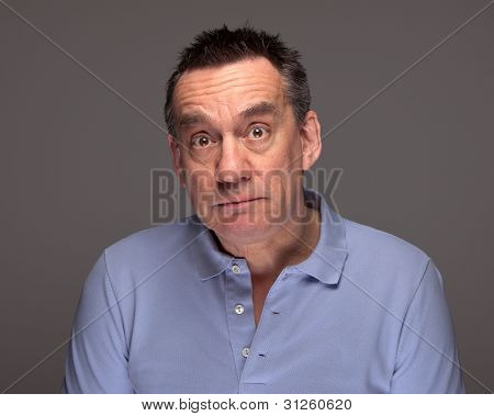 Man with Surprised Sad Expression on Grey Background