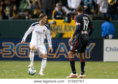 CARSON, CA. - MAY 7: Los Angeles Galaxy M David Beckham #23 keeps the ball away from New York Red Bulls F Thierry Henry #14 during the MLS game on May 7 2011 at the Home Depot Center in Carson, CA.