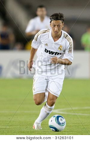 LOS ANGELES - JULY 16: Real Madrid C.F. M Mesut Ozil #23 during the World Football Challenge game between Real Madrid & the Los Angeles Galaxy on July 16 2011 at the Los Angeles Memorial Coliseum in Los Angeles, CA.