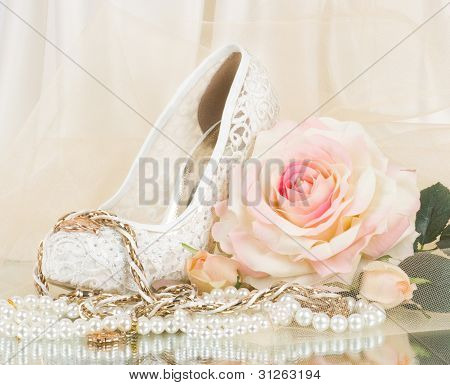 The beautiful bridal rose with wedding shoe and beads