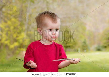 Young Boy Playing Outdoors