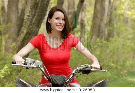 Woman On A 4 Wheel Atv