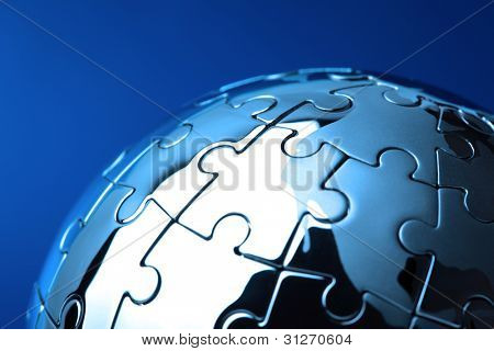 Globe puzzle concept for business solutions and strategy on blue background