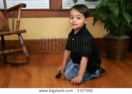 Young Boy Playing With Trains