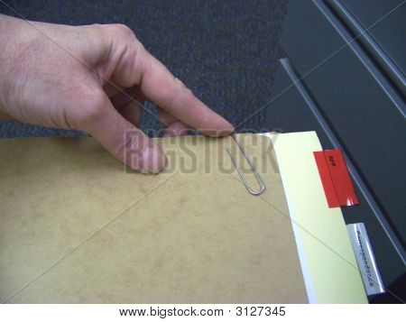 Hand & Paper Clip With File Folders
