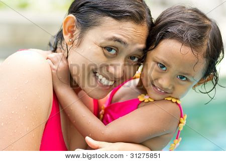 Asian Mother And Child In Swimsuit