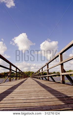 Long Walk Wooden Sirvenos Lake Bridge In Astravas