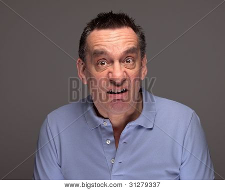 Man Pulling Funny Grimace Face on Grey Background