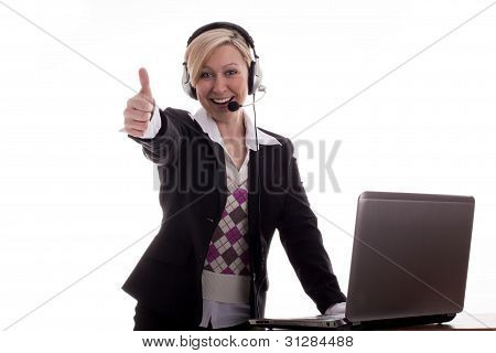 Businesswoman With Laptop Thumbs Up