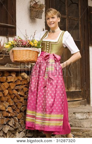 Young girl with Easter bouquet Bavarian