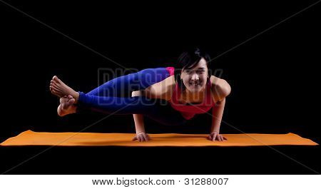 Woman exercise yoga asana - arm balance