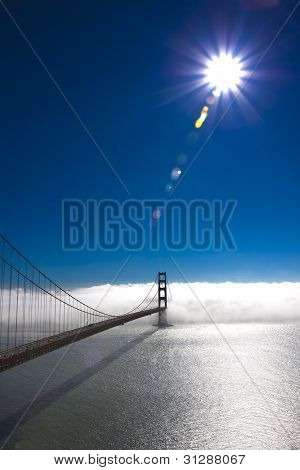 Golden Gate Bridge with sun and fog