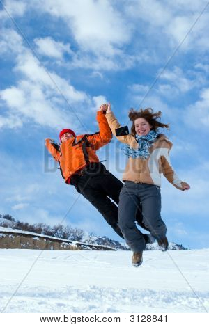 Couple Jumping Over Blue Sky In Winter Mountains Tien Shan (Series Sport, Extreme, Mountains,