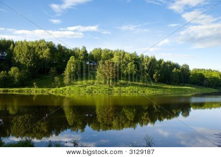 Blue Reflection In River  At Summer Forest, Russia