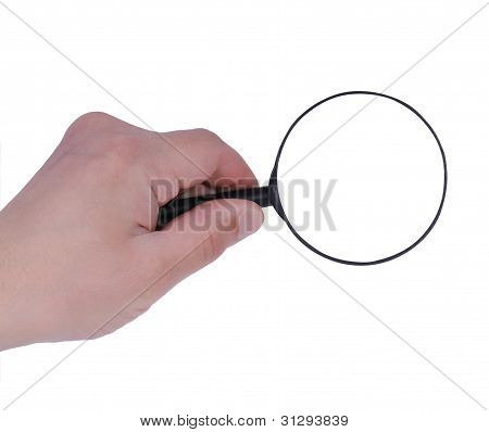 Hand holds a magnifying glass
