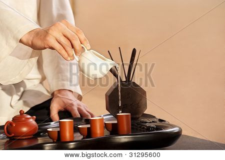 A Young Man Holds A Chinese Tea Ceremony
