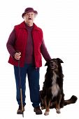 Active Senior Woman With Walking Stick And Dog