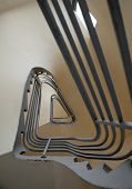 image of bannister  - spiral stairs with metal bannister forming a triangle shape - JPG