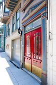 image of entryway  - Red doors highlight the entryway to an historic home in downtown San Francisco - JPG