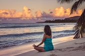 Woman Doing Yoga On Tropical Beach In Vacation. Young Woman Traveler Doing Yoga In Vacation. Travele poster