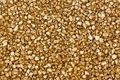 picture of gold glitter  - A golden shiny coloured background or texture - JPG