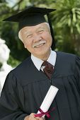 stock photo of early 60s  - Smiling Senior Graduate - JPG