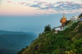 Kyaiktiyo Pagoda Also Known As Golden Rock Is A Well-known Buddhist Pilgrimage Site In Myanmar, Nigh poster