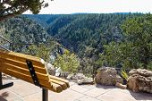 Bench Enjoying The View In Walnut Canyon National Monument In Flagstaff Arizona poster