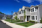 stock photo of row houses  - Row of new town homes waiting for occupancy - JPG