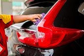 Selcective Focus To Staff Using Squeegee To Clean The Rear Window Car. Car Service In Gas Station. poster