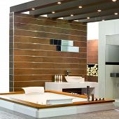 stock photo of lavabo  - Contemporary bathroom with wooden walls and spa bathtub - JPG