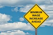 Minimum Wage Increase Ahead Caution Sign Blue Sky Background poster